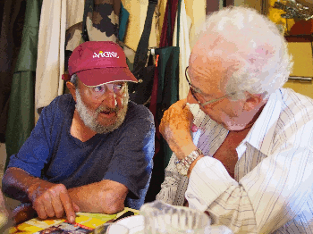 Pierrot, who has exchanged his felt hat for a baseball cap here, discusses the Coscione plateau with my father-in-law;
