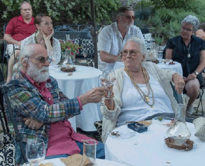 Jae offers a toast to her husband Andor at the Corsican wine-tasting she helped organise this summer.
